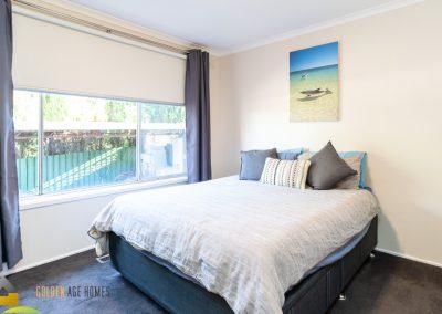 Photo of the Norwood's generously sized master bedroom. Large sliding window. Carpet floor
