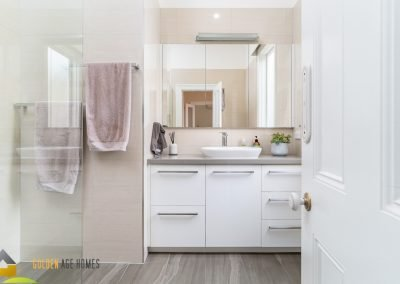 A modern bathroom with walk-in shower. The Bayview, house for relocation in Melbourne